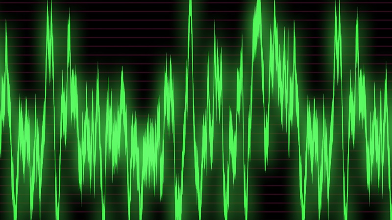Large green graph of sound waves on the oscilloscope
